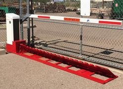 DOMINATOR™ Motorized Surface Mount Traffic Wedge Barrier System